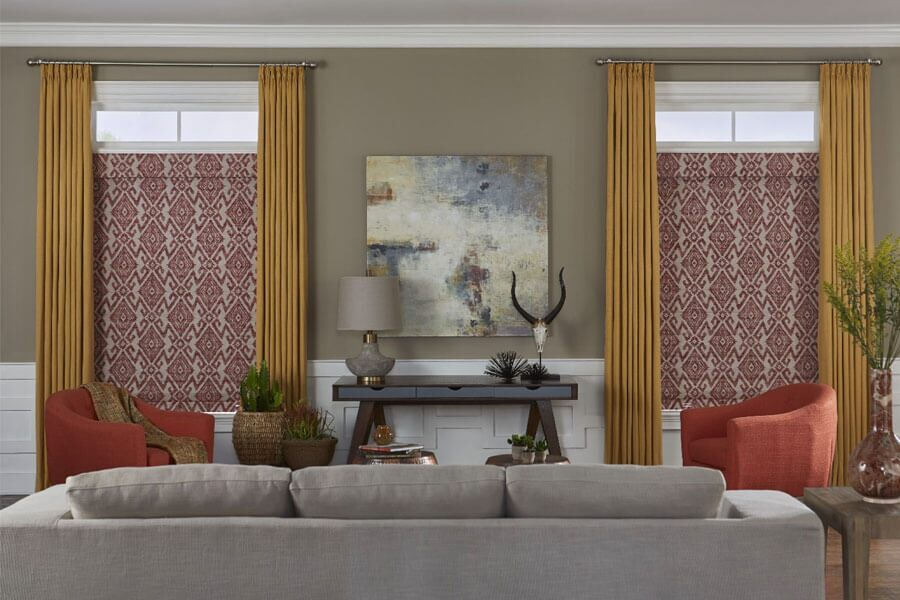 Formal Living Room With Gray Upholstered Sofa Facing A Beige Wall With An  Abstract Painting Flanked